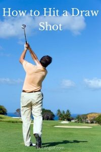Guy practising how to hit a draw shot in golf