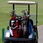 Picture of a motorized golf carts on the course