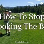 Golfer following advice on how to stop hooking the ball